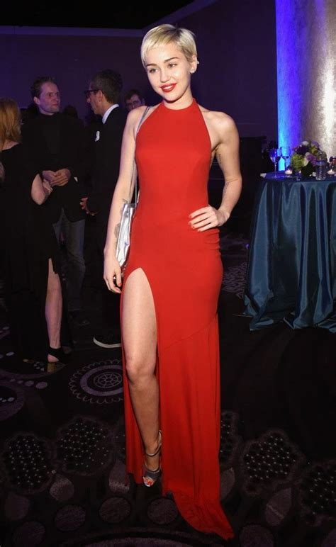Miley Cyrus looks red hot in a thigh-slit dress at the